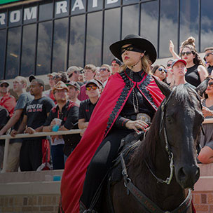 Texas Tech Red Raider, Rachel McLelland, atop her equine companion Fearless Champion.